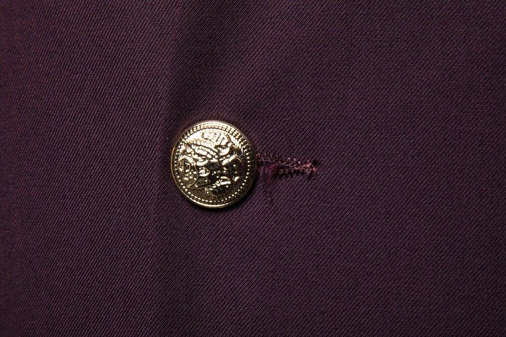 vestimenta decorativa com botão