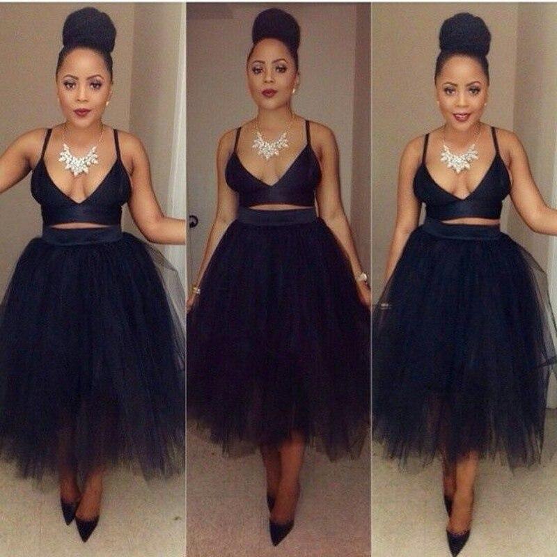 Модная черная юбка средней длины из тюля