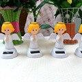 Precio al por mayor 5 Unidades Por Lote Columpio Bajo Plena Luz No Batería Novedad Lucky Juguete Baile Feliz Ángel de la Energía Solar niñas