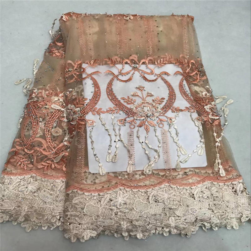 Latest African Laces Fabrics Embroidered African tulle French Lace Fabric with a lot stones peach color french mesh laceLatest African Laces Fabrics Embroidered African tulle French Lace Fabric with a lot stones peach color french mesh lace