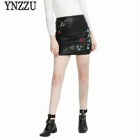 YNZZU Vintage Embroidery Leather Skirt Women Autumn Sexy Bandage Pencil Mini Skirt Elegant Women Faux Leather