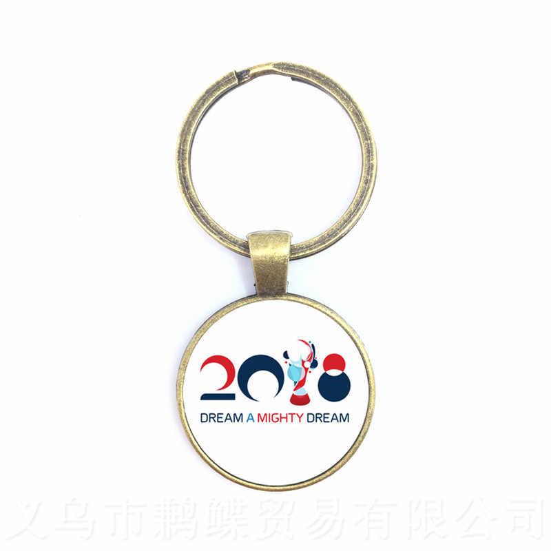 Uruguai, Espanha Da Equipa de Futebol LOGO Abu Dhabi Waka Keychain 2018 Titan Cup Mascote Logotipo Do Futebol Fãs Lembrança Chaveiro Para Fo