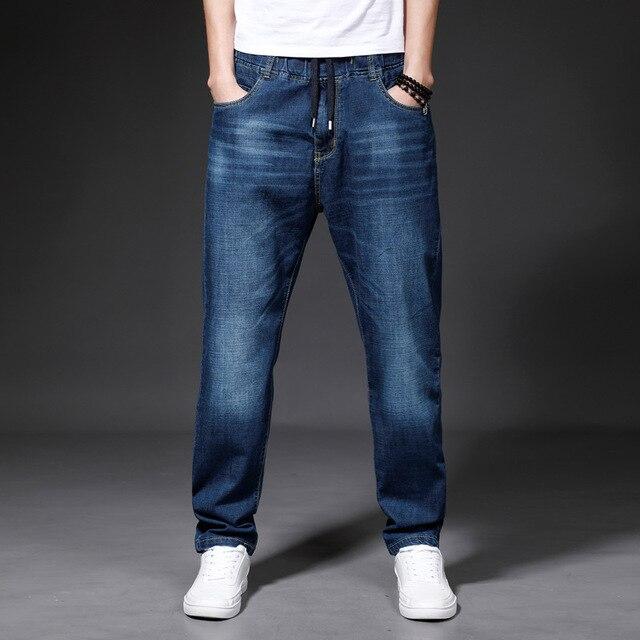 e2341d034a5e5 SHABIQI Brand Men s Jeans High Quality Loose Elastic Waist Large Size Denim  Plus Fertilizer To Increase Men s Fat Denim Trousers