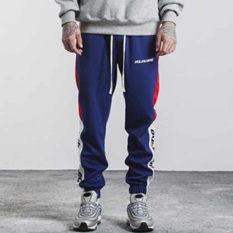 ZOGAA 2019 erkekler pantolon tam boy yan şerit baskılı pantolon erkek Joggers spor spor spor salonu pantolonu erkek Vintage Sweatpants