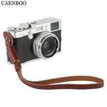 Caenboo Универсальный Пояса из натуральной кожи Камера запястье ремешок ручка для Canon Nikon Sony Fuji Leica беззеркальных/цифровые зеркальные Камера