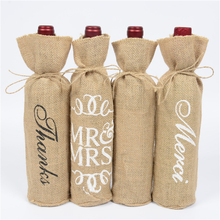 Купить с кэшбэком 100pcs Christmas Natural Jute Wine Bottle Covers Gift Bags Blind Packaging Hessian Linen Pouch Wedding Red Wine Champagne Bag