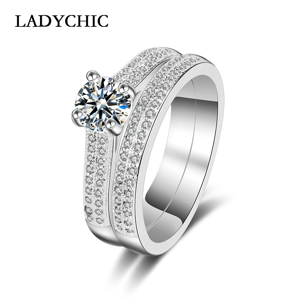 This is a graphic of LADYCHIC Double Rings for Lover Couples Men Women White Gold Color Wedding Ring Sets High Quality AAA+ Zircon Inlay LR47
