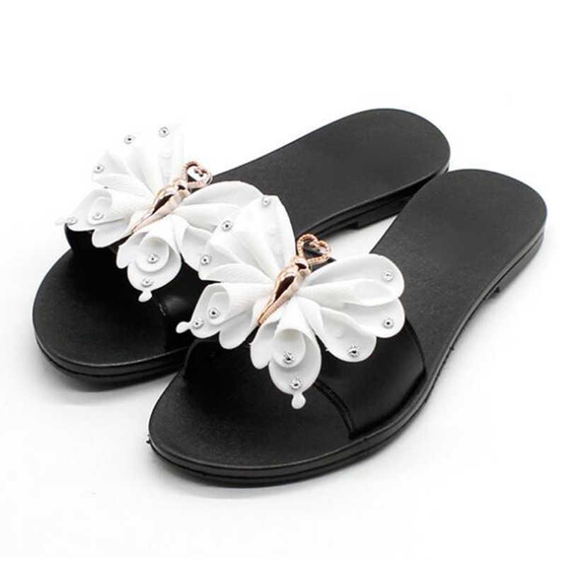 5592e89a2cb4 ... COVOYYAR Lovely Bow Women Slides Black Home Outside Flat Beach Shoes  Summer Rhinestone Plastic Jelly Slippers ...