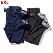 Outono novo estiramento calças de brim masculinas tamanho grande solto em linha reta confortável calças masculinas cor sólida denim 6xl 5xl 4xl 3xl