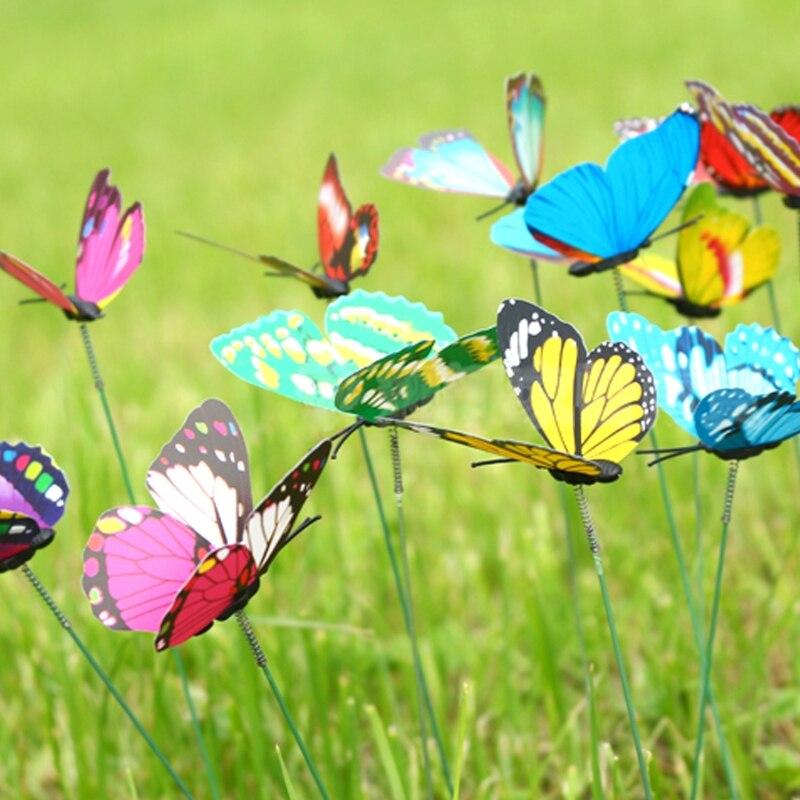 Hadas colorida mariposa en palo ornamento jardn csped del