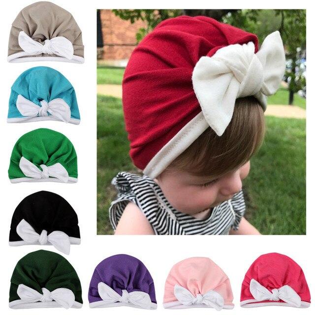 Newborn toddler baby boy hit color rabbit ear bow Indian hat winter warm  cotton cap 2019 ab186c7bd37