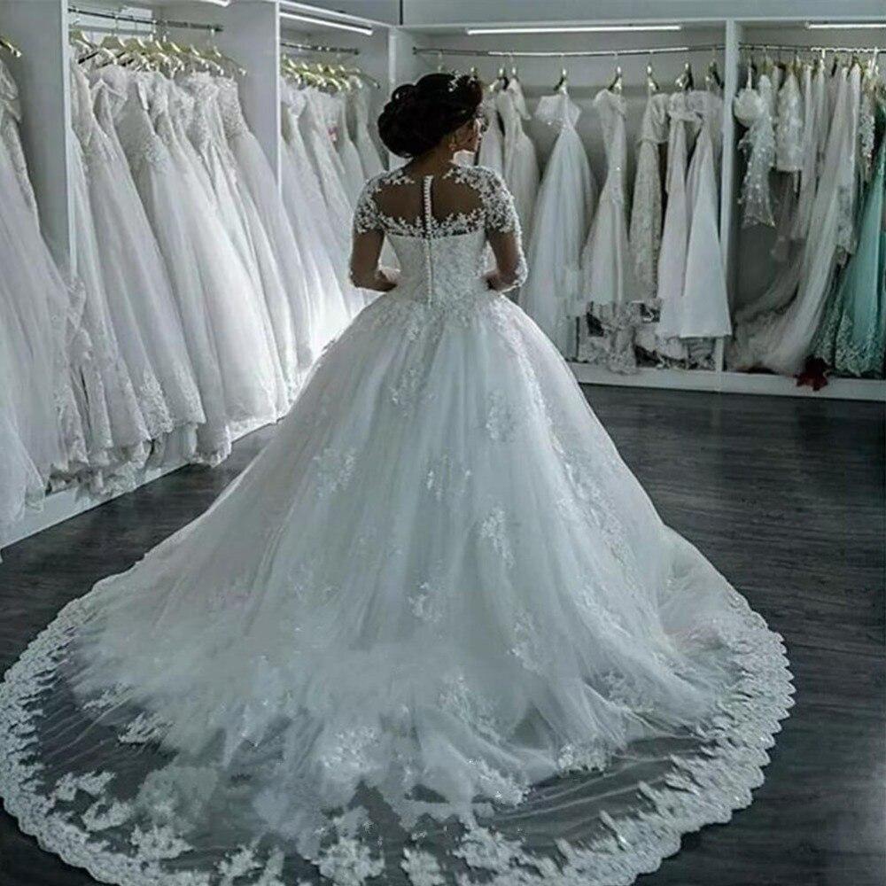 https://ae01.alicdn.com/kf/HTB1EO8NXLvsK1RjSspdq6AZepXaw/Vestidos-De-Noiva-2018-Elegant-A-Line-Long-Sleeve-Wedding-Dress-Tulle-Appliques-Beaded-Princess-Lace.jpg