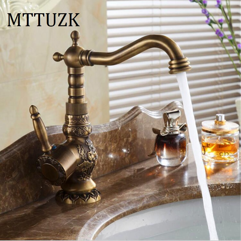 цены  MTTUZK Deck Mounted Single Handle Bathroom Faucet Basin Carved Faucet Antique Brass Hot and Cold Mixer tap 360 degree rotating