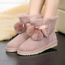 Sweet and lovely warm light wear-resistant hair ball decoration womens snow boots sheep fur one in the winter shoes