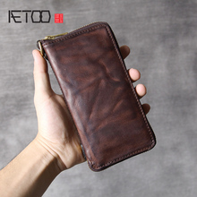 купить AETOO Retro do old multifunctional long wallet head layer cowhide hand bag male and female leather mobile phone bag по цене 3264.83 рублей