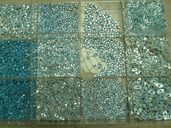 100 pcs 4x8 5x10 7x14mm Top Qualité Véritable MOP Shell mère de perle Yeux mauvais Marquise Bleu Blanc Cabochons perles