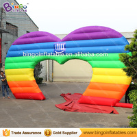 Hot sale 7X4 m inflatable heart shaped arch in rainbow color for wedding party decoration colorful archway for Valentine's Day