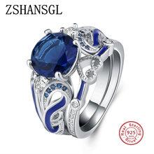 284c5283dd6d Exquisito diseño de amor corona mano corazón Claddagh anillo AAA 925 Plata  azul CZ anillos de cristal para la joyería de las muj.