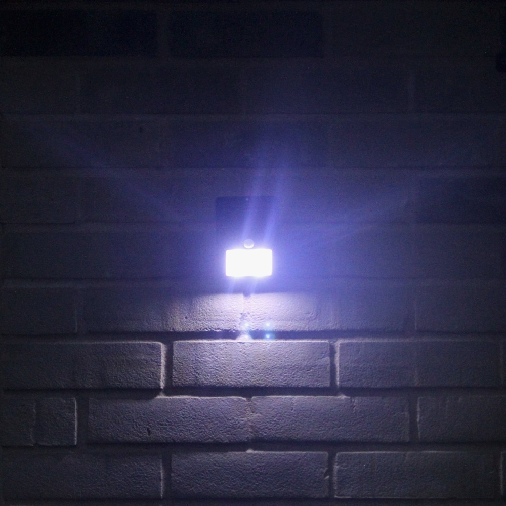Rechargeable solar panel led wall lamp motion sensor detection rechargeable solar panel led wall lamp motion sensor detection waterproof security night light energy saving for outdoor use in solar lamps from lights mozeypictures Images