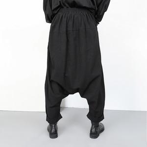 Image 4 - [EAM] جديد ربيع خريف 2020 عالي المرونة الخصر الأسود زر انقسام مشترك واسعة الساق السراويل الطويلة فضفاضة النساء بنطلون موضة YG2