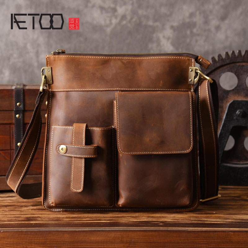 AETOO Men 's vertical handbag European and American shoulder Messenger bag business leather file package retro simple simple solid colour and zippers design men s messenger bag