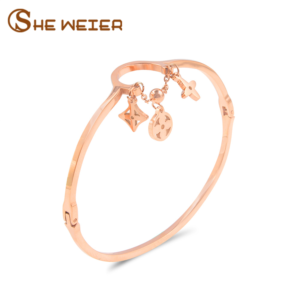 все цены на SHE WEIER Clover Fashion Stainless Steel Bracelets & Bangles For Women pulseiras rose gold bangle bracelet personalized