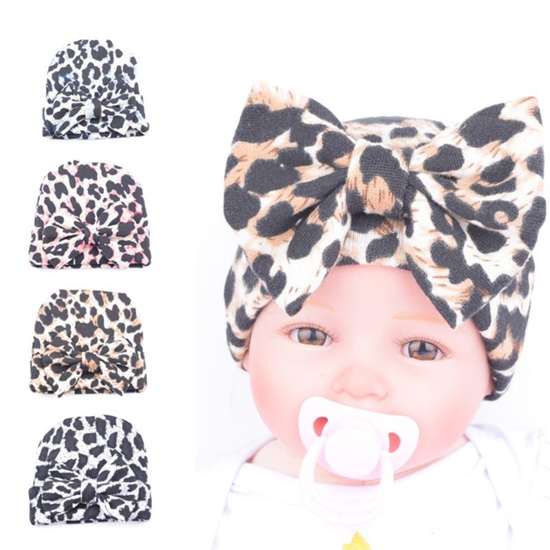 DreamShining Cute Bowknot Baby Hat Leopard Printed Kids Girls Cap Beanie Winter Warm Newborn Hats 0-3 Months Accessories