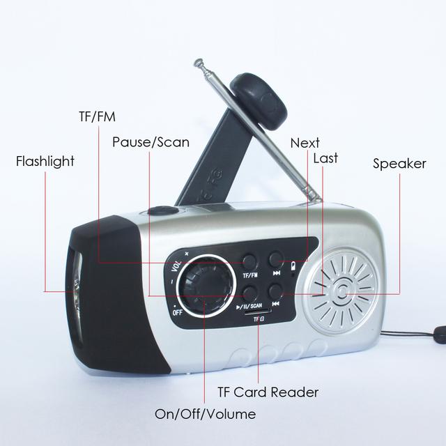 Manivela Dynamo Linterna Solar recargable TF/FM Radio Cargador de Teléfono USB