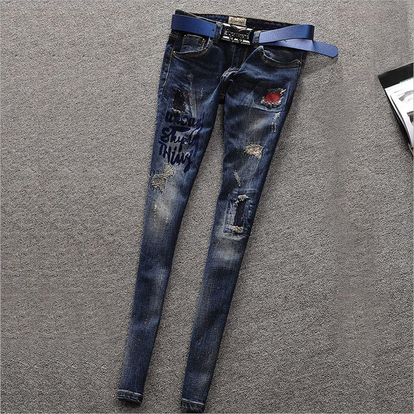 ФОТО Spring and autumn cotton printing burst badges pencil pants ladies jeans European station hole and Elasticity jeans w1913