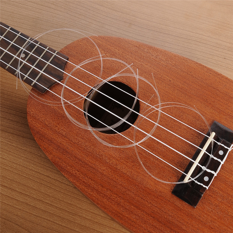 Ukulele Strings Nylon String Ukulele Part & Accessories Ukulele Small Guitar Strings 0.56mm/0.71mm/0.81mm/0.56mm 4 In 1 Set