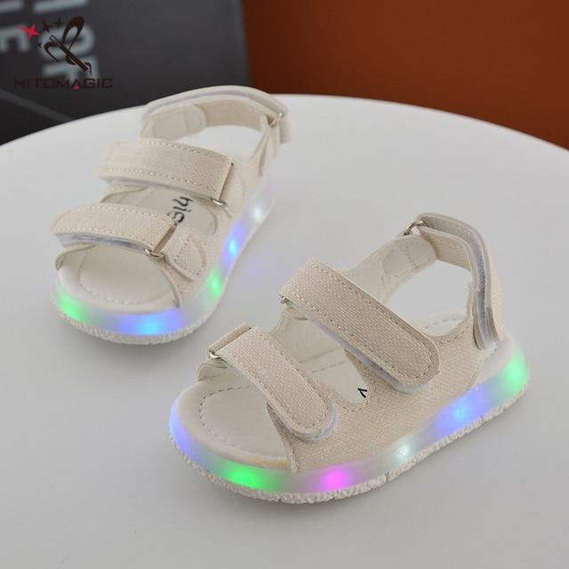 29402e1e9 HITOMAGIC niños zapatos del bebé sandalias para niños con luces brillantes  zapatillas con suela luminosa Led