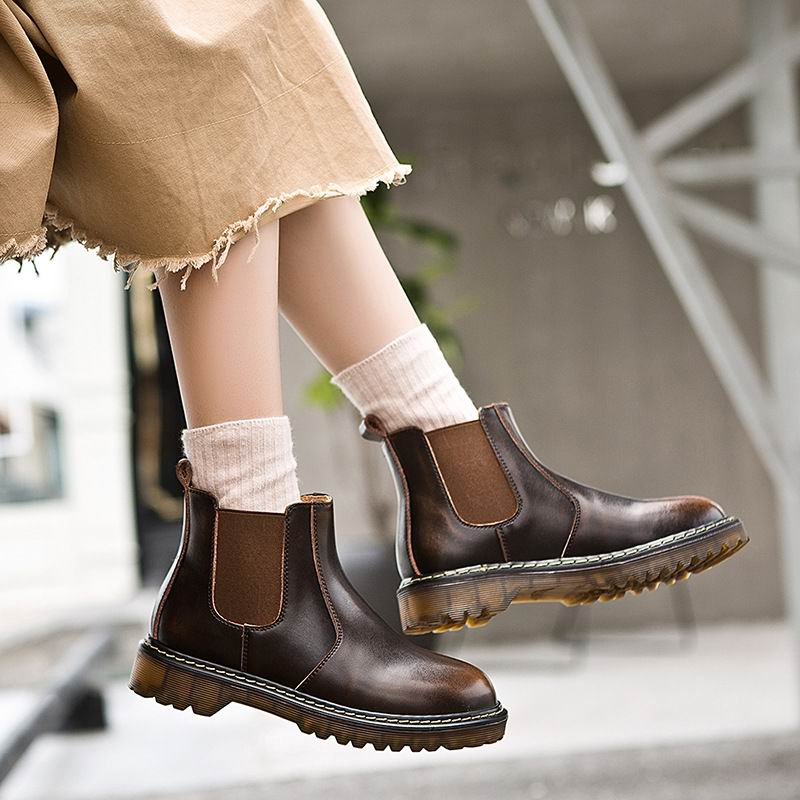 woman brown shoes