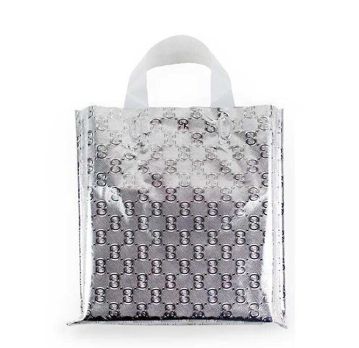 Qi Wholesale Size 40 40cm 50pcs lot Aluminum Foil Clothes Plastic Bag  Silver Gift Bag Packing With Handle Upscale Shopping Bag -in Gift Bags    Wrapping ... aeca519fe9