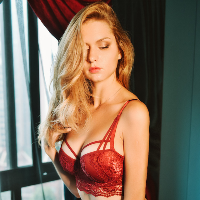 Sexy lace bra with small breasts and a red biennial bra on the side 1