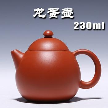 Authentic Yixing Zisha masters handmade teapot gold ore Niqiu Zhu hole hole water polo egg pot 97