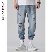 цены UNCLEDONJM Men Stretchy Ripped Biker Jeans Destroyed Hole Taped Regular Fit Denim Scratched Plus Size Jean Cross Pants 513W