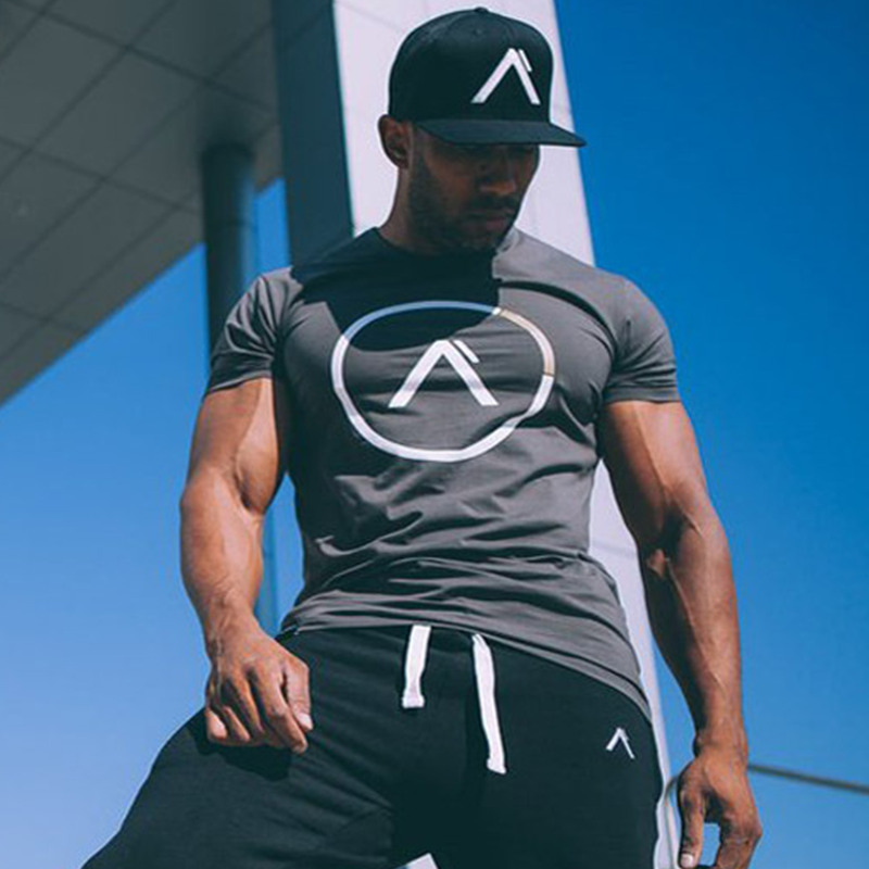 New Summer time Model Males Cotton Brief Sleeve T Shirt Exercise Health Bodybuilding Shirts Male Model Tee Tops Style Informal Clothes
