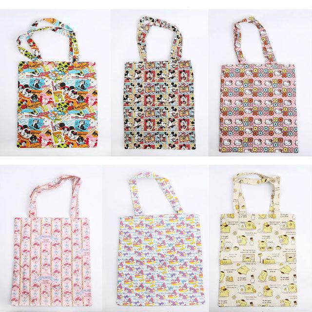 7c1dc5496821a Tsum Tsum Alışveriş Çantası Minnie Mickey mouse Kitty Pürin depolama tuval  çanta karikatür baskı İpli çanta