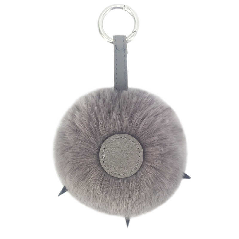 Llaveros de pompón de piel mullida nuevo oso pata de felpa llavero colgante bolsos decoración de coche accesorios personalizados para mujer 2018
