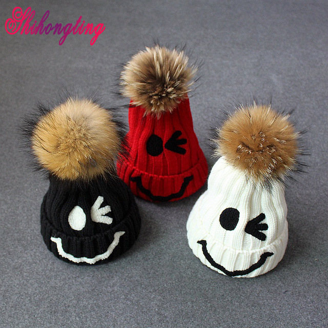New Fashion Smile Face Hats & Caps Unisex Cute Squinting Cap Female Raccoon Fur Ball Handmade Knitting Hats Ski Gorros ZZM005