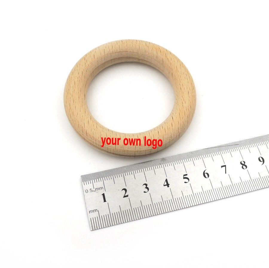 Jouets de dentition en bois naturel 70mm logo personnalisé bricolage anneau de hêtre organique rond en bois de hêtre bébé jouets de dentition enfant en bas âge