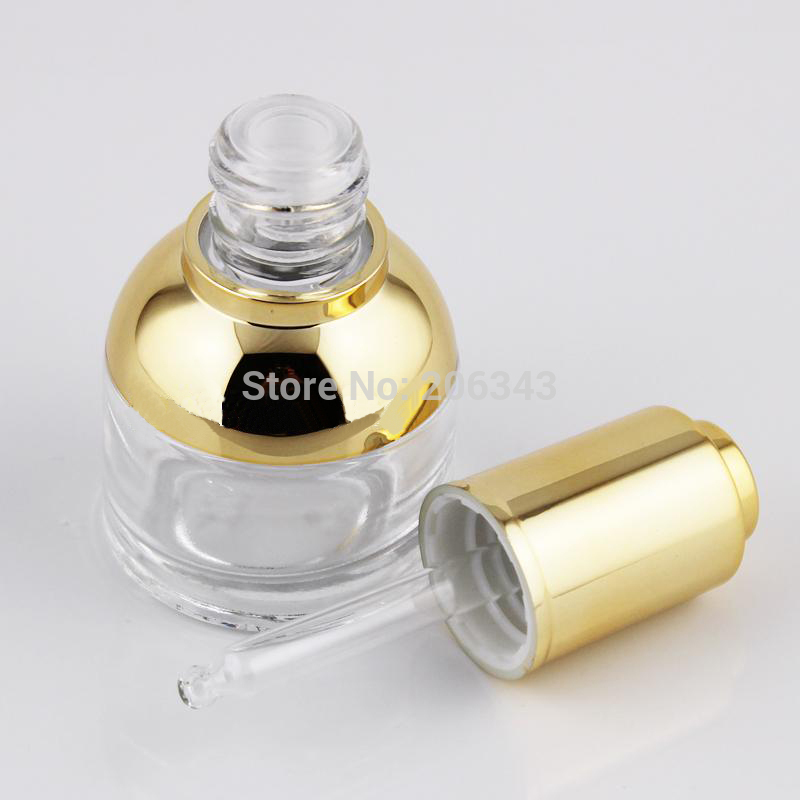 NEW ARRIVAL 30ml transparent glass dropper bottle with gold shoulder and gold press dropper ,white bulb glass bottle