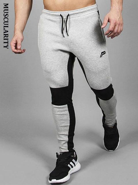fbafc8bc65144 Muscularité léger taille élastique hommes pantalons de survêtement mâle  coton Harem pantalon Joggers décontracté hommes Joggers