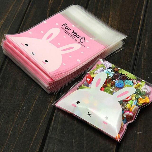 0d9513a2f6f07 100 قطع أكياس التعبئة والتغليف لطيف الوردي أرنب الهدايا أكياس حلوى  بلاستيكية الكوكيز عيد ميلاد الزفاف