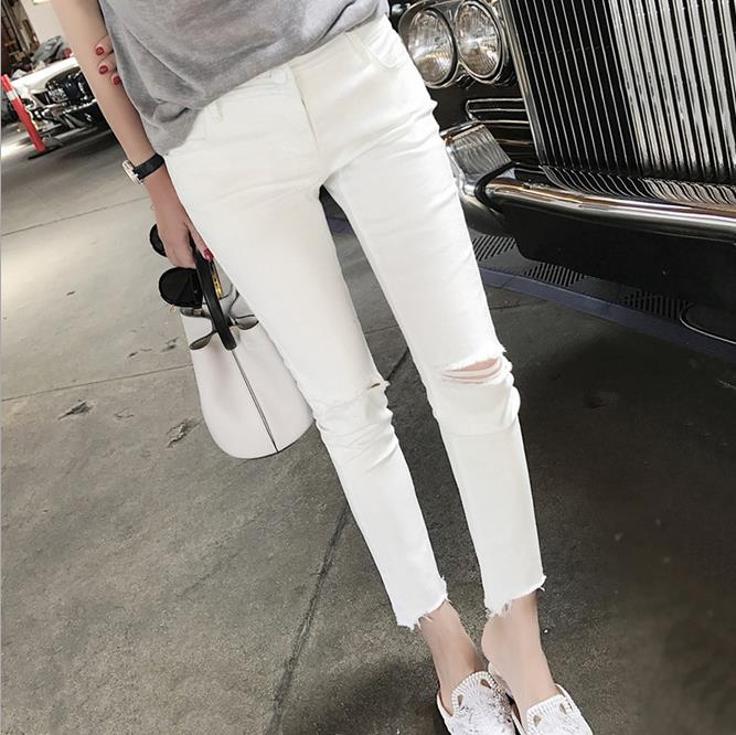 Women's fashion brands of high-end new white all-match hole pencil denim pants nine jeans europe in the spring of 2016 new pink panther hole fashion sequins all match feet jeans