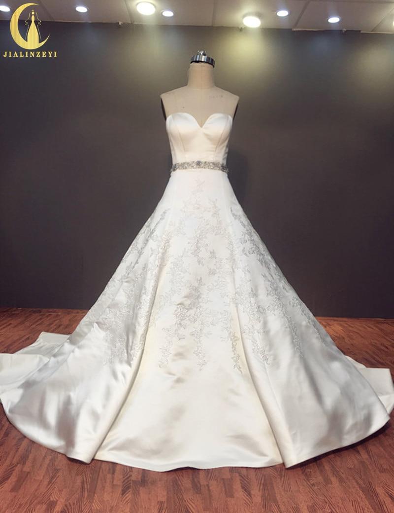 Rýže Skutečný vzorek Sexy srdíčko Satén s krajkou Aplikácie Krajka nahoru Soud Vlak Elegent Svatební Svatební šaty Svatební šaty