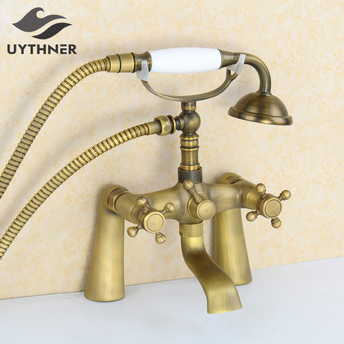 New US Free Shipping Deck Mount Solid Brass Bathroom Tub Faucet Antique Brass Mixer Tap W/ Handheld Shower Dual Handles wall mount single handle bath shower faucet with handshower antique brass bathroom shower mixer tap