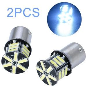 Image 1 - 2pcs 12V BA15S 1156 7020 Turn Signal Light 21LED Super White Tail Backup Reverse Brake Light Bulb for Car Lighting
