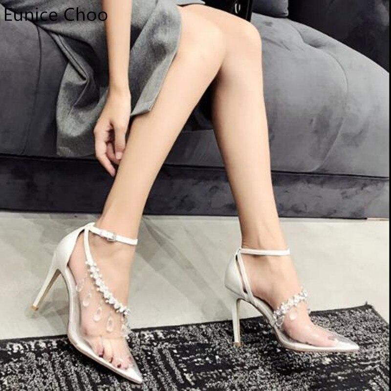 Pic Nueva As Moda 2018 Boda Punta Mujer Feminino Sexy Pvc Bombas Dedo  Decoración Pie Sapato Zapatos Tacones Rhinestone Del Partido Altos qRHFdRw f30908ead7f2