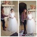 Blanco / marfil encaje transparente medias mangas cuello del barco de la boda del florista vestidos largos apliques de primera comunión vestidos de bola para fiestas